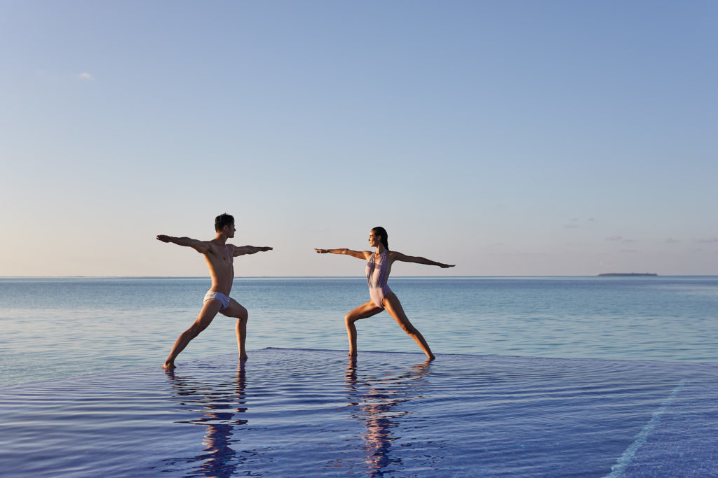 CONRAD MALDIVES - Couple_Yoga_Quiet Zone Pool_credit Justin Nicholas - hi-res
