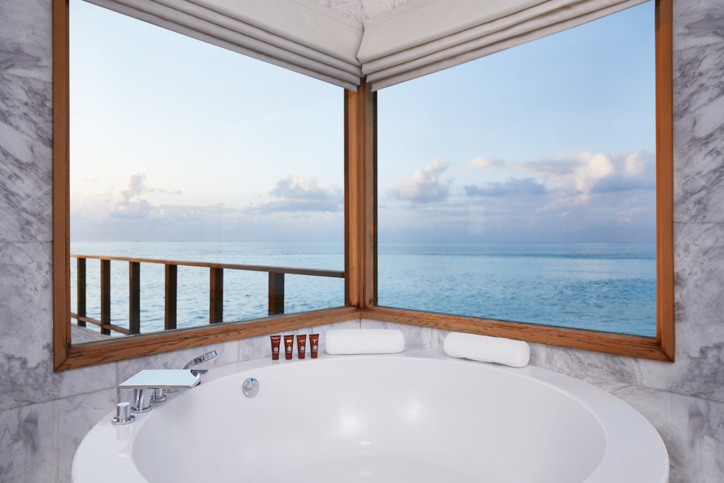 CONRAD MALDIVES RANGALI ISLAND_Villas_Fam_Sunset Water Villa Bathroom_credit Justin Nicholas hi-res