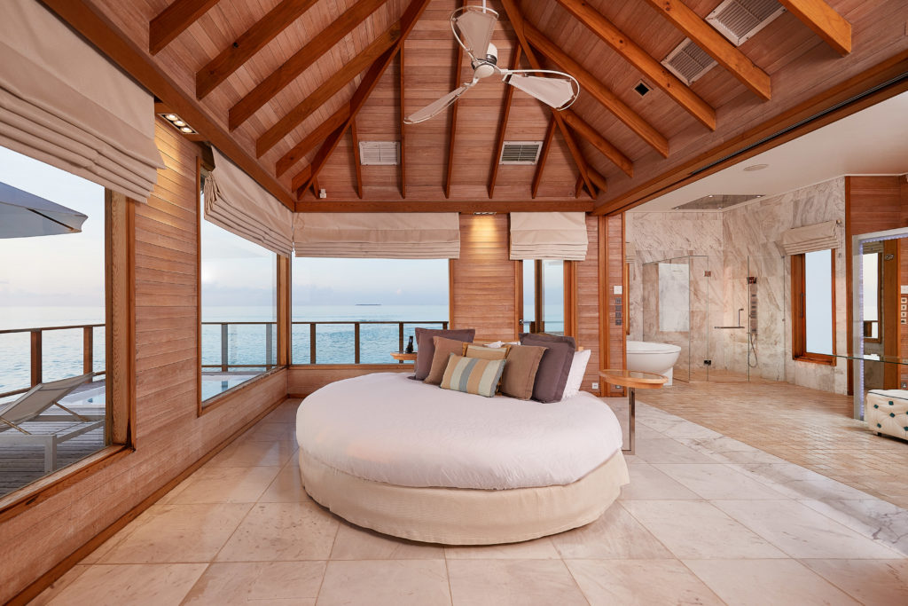 CONRAD MALDIVES RANGALI ISLAND_Villas_Sunset Water Villa Bedroom_credit Justin Nicholas hi-res