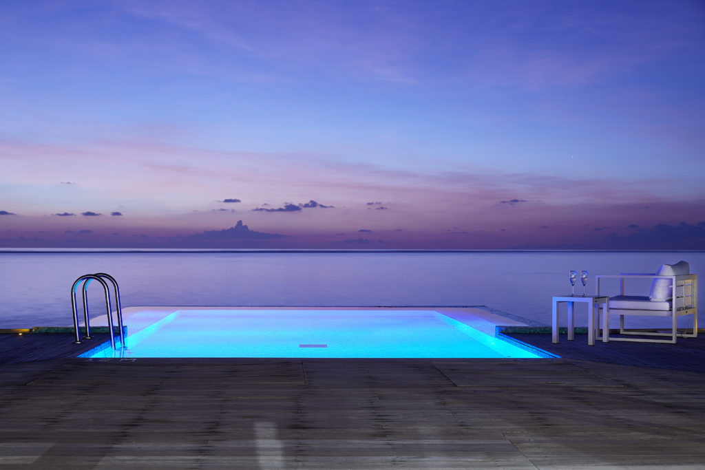 CONRAD MALDIVES RANGALI ISLAND_Villas_detail_Sunset Water Villa Deck Night_credit Justin Nicholas hi-res