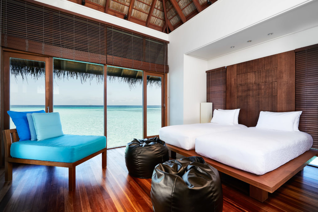 CONRAD MALDIVES _Family Water Villa_Bedroom_credit Justin Nicholas - hi-res
