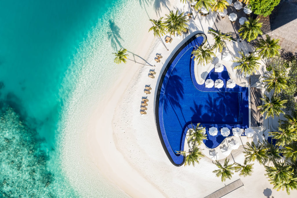 CONRAD MALDIVES_Aerial_Beauty Shot_Rangali Finolhu Island Main Pool_Hero_credit Justin Nicholas - hi-res