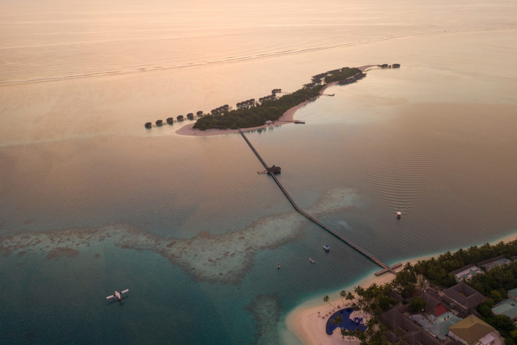 CONRAD MALDIVES_Aerial_Sunset_ Hero_credit Justin Nicholas - hi-res